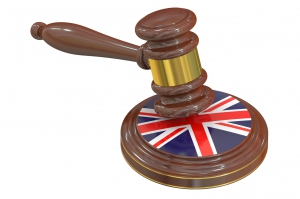 Wooden Gavel with United Kingdom Flag, 3D rendering